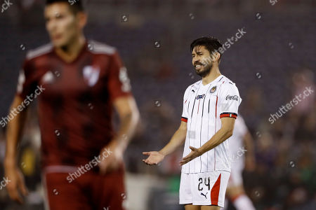 Chivas forward Oribe Peralta, right, reacts during the second half of the team's Colossus Cup soccer match against River Plate, in San Diego