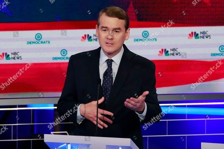Democratic presidential candidate Colorado Sen. Michael Bennet speaks during the Democratic primary debate hosted by NBC News at the Adrienne Arsht Center for the Performing Arts, in Miami. It's been tough to run for the Democratic presidential nomination as a moderate if your name isn't Joe Biden. But some candidates hope that's changing