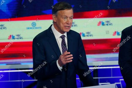 Democratic presidential candidate former Colorado Gov. John Hickenlooper speaks during the Democratic primary debate hosted by NBC News at the Adrienne Arsht Center for the Performing Arts, in Miami. It's been tough to run for the Democratic presidential nomination as a moderate if your name isn't Joe Biden. But some candidates hope that's changing