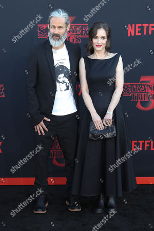 Winona Ryder (R) and her partner Scott Mackinlay Hahn (L) pose for photos on the red carpet prior to the premiere of 'Stranger Things: Season 3' in Santa Monica, California, USA, 28 June 2019. The television show will be released on 04 July 2019.