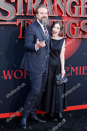 Winona Ryder (R) and US actor David Harbour (L) pose for photos on the red carpet prior to the premiere of 'Stranger Things: Season 3' in Santa Monica, California, USA, 28 June 2019. The television show will be released on 04 July 2019.