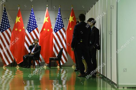 Stock Photo of Chinese officials wait in the corridors outside a bilateral meeting between Chinese President Xi Jingping and US President Donald Trump during the second day of the  summit in Osaka, Japan, 29 June 2019. It is the first time Japan will host a  summit. The summit gathers leaders from 19 countries and the European Union to discuss topics such as global economy, trade and investment, innovation and employment.