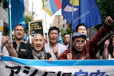 Temtselt Shobshuud, Rebiya Kadeer. Temtselt Shobshuud, right, chairman of the Southern Mongolia Congress, and Uyghur human rights activist Rebiya Kadeer chant slogans during a rally against the Chinese government on the last day of the G-20 summit, in Osaka, western Japan