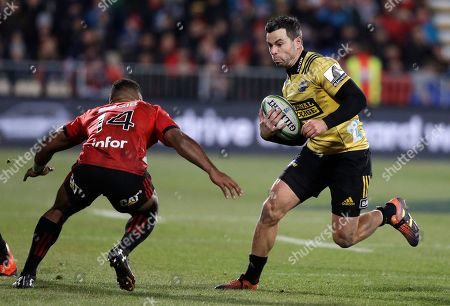 Stock Photo of Hurricanes James Marshall runs at Crusaders Sevu Reece, left, during the Super Rugby semifinal between the Crusaders and the Hurricanes in Christchurch, New Zealand