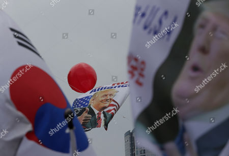 """A huge flag with a picture of U.S. President Donald Trump is seen during a rally to welcome his visit in Seoul, South Korea, . North Korea said Saturday President Donald Trump's offer to meet leader Kim Jong Un at the Korean Demilitarized Zone is a """"very interesting suggestion,"""" brightening prospects for a third face-to-face meeting between the two leaders"""
