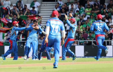 Afghanistan's Rashid Khan, second left, celebrates with teammates after the dismissal of Pakistan's Haris Sohail during the Cricket World Cup match between Pakistan and Afghanistan at Headingley in Leeds, England