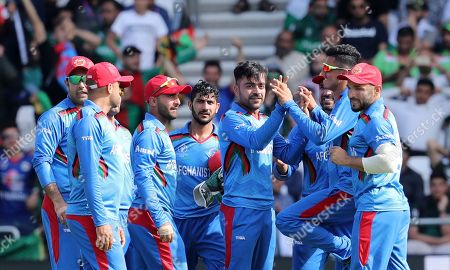 Stock Picture of Afghanistan's Rashid Khan, center right, celebrates with teammates after the dismissal of Pakistan's Haris Sohail during the Cricket World Cup match between Pakistan and Afghanistan at Headingley in Leeds, England