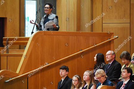 Jackie Kay, makar, Scottish poet laureate, delivers a speech as Queen Elizabeth II, accompanied by Prince Charles, who is known as the Duke of Rothesay when in Scotland, attends a ceremony to mark the 20th Anniversary of the Scottish Parliament in Edinburgh, Scotland, 29 June 2019. The ceremony took place almost two decades to the day since the Scottish Parliament officially assumed its legal powers.