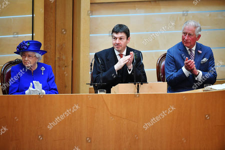 Queen Elizabeth II, accompanied by Prince Charles, who is known as the Duke of Rothesay when in Scotland and Ken Macintosh (C), Presiding Officer of the Scottish Parliament, listens to speeches and music as she attends a ceremony to mark the 20th Anniversary of the Scottish Parliament in Edinburgh, Scotland, 29 June 2019. The ceremony took place almost two decades to the day since the Scottish Parliament officially assumed its legal powers.