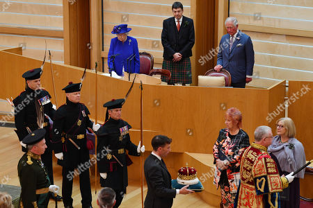 epa07682252 Alexander Douglas Douglas-Hamilton (C), 16th Duke of Hamilton and the Premier Peer of Scotland, carries the Scots Crown out from parliament as Queen Elizabeth II, accompanied by Prince Charles, who is known as the Duke of Rothesay when in Scotland, attends a ceremony to mark the 20th Anniversary of the Scottish Parliament in Edinburgh, Scotland, 29 June 2019. The ceremony took place almost two decades to the day since the Scottish Parliament officially assumed its legal powers.