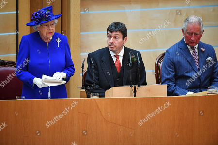 Queen Elizabeth II, accompanied by Prince Charles, who is known as the Duke of Rothesay when in Scotland, delivers a speech alongside Ken Macintosh (C), Presiding Officer of the Scottish Parliament,she attends a ceremony to mark the 20th Anniversary of the Scottish Parliament in Edinburgh, Scotland, 29 June 2019. The ceremony took place almost two decades to the day since the Scottish Parliament officially assumed its legal powers.
