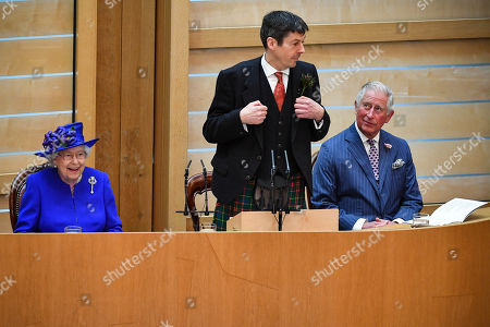Queen Elizabeth II, (L) accompanied by Prince Charles, (R) who is known as the Duke of Rothesay when in Scotland, listens to Ken Macintosh (C), Presiding Officer of the Scottish Parliament describing how to sign Scotland in sign language, as she attends a ceremony to mark the 20th Anniversary of the Scottish Parliament in Edinburgh, Scotland, 29 June 2019. The ceremony took place almost two decades to the day since the Scottish Parliament officially assumed its legal powers.