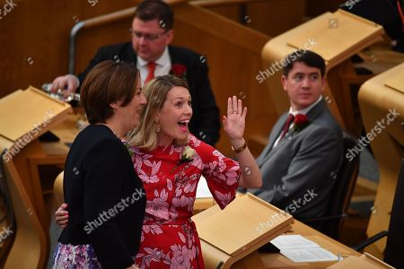 Stock Photo of (L-R) Members of the Scottish Parliament Kezia Dugdale and Jenny Gilruth  in Scottish Parliament as Queen Elizabeth II, accompanied by Prince Charles, who is known as the Duke of Rothesay when in Scotland, is due to attend a ceremony to mark the 20th Anniversary of the Scottish Parliament in Edinburgh, Scotland, 29 June 2019. The ceremony took place almost two decades to the day since the Scottish Parliament officially assumed its legal powers.