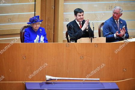 Queen Elizabeth II, (L) accompanied by Prince Charles, who is known as the Duke of Rothesay when in Scotland, and Ken Macintosh (C), Presiding Officer of the Scottish Parliament, listen to speeches and music as they attend a ceremony to mark the 20th Anniversary of the Scottish Parliament in Edinburgh, Scotland, 29 June 2019. The ceremony took place almost two decades to the day since the Scottish Parliament officially assumed its legal powers.