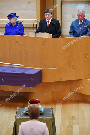 Queen Elizabeth II, (L) accompanied by Prince Charles, (R) who is known as the Duke of Rothesay when in Scotland, and Ken Macintosh (C- top), Presiding Officer of the Scottish Parliament, listens to Nicola Sturgeon (C-bottom), Scottish First Minister, as they attend a ceremony to mark the 20th Anniversary of the Scottish Parliament in Edinburgh, Scotland, 29 June 2019. The ceremony took place almost two decades to the day since the Scottish Parliament officially assumed its legal powers.