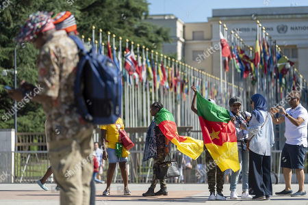 Cameroonian nationals living in various European countries demonstrate against the presence of Cameroon's President in Geneva, on the Place des Nations in front of the European headquarters of the United Nations in Geneva, Switzerland, 29 June 2019. Cameroon's President Paul Biya is currently in Geneva.