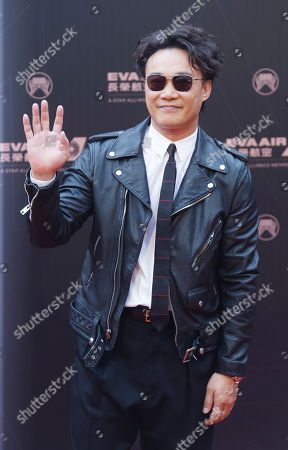 Hong Kong singer Eason Chan smiles as he arrives at the 30th Golden Melody Awards in Taipei, Taiwan, . Chan is nominated as Album of the Year and Song of the Year for his album ''L.O.V.E.'' at this year's Golden Melody Awards, one of the world's biggest Chinese-language pop music annual events
