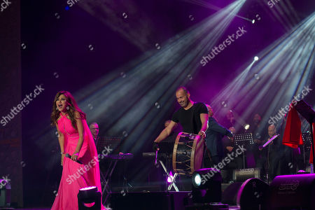 Najwa Karam (L) performs on stage during the 18th International Mawazine Music Festival in Rabat, Morocco, 28 June 2019. The festival will run from 21 June to 29 June 2019.
