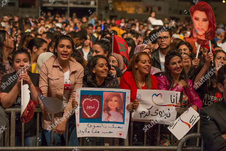 People listen to Lebanese singer Najwa Karam performing on stage during the 18th International Mawazine Music Festival in Rabat, Morocco, 28 June 2019. The festival will run from 21 June to 29 June 2019.