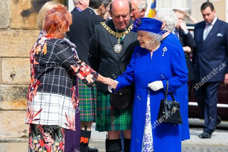 Stock Image of Britain's Queen Elizabeth II shakes hands with Scottish Deputy Presiding Officer Christine Grahame (L) as she attends a ceremony to mark the 20th Anniversary of the Scottish Parliament in Edinburgh, Scotland, 29 June 2019. The ceremony took place almost two decades to the day since the Scottish Parliament officially assumed its legal powers.