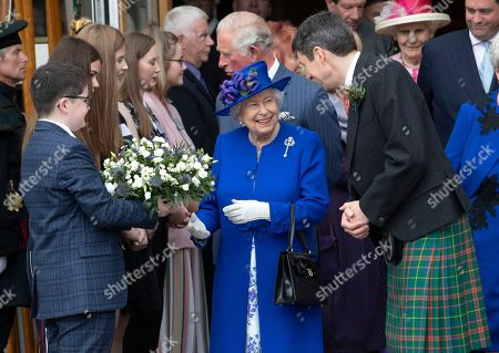 Queen Elizabeth II, accompanied by Ken Macintosh, Presiding Officer of the Scottish Parliament, meets members of Young Scot at the Scottish Parliament in Edinburgh during a ceremony marking the 20th anniversary of devolution