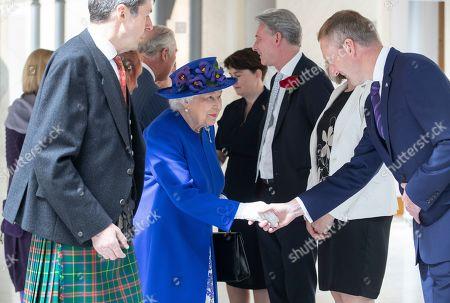 Queen Elizabeth II meets Scottish Liberal Democrat Tavish Scott in the Garden Lobby of the Scottish Parliament in Edinburgh during a ceremony marking the 20th anniversary of devolution