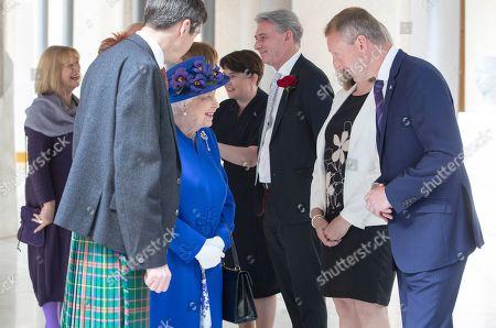 Queen Elizabeth II meets Scottish Liberal Democrat Tavish Scott (right) in the Garden Lobby of the Scottish Parliament in Edinburgh during a ceremony marking the 20th anniversary of devolution