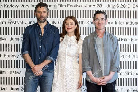 Bart Freundlich, US actress Julianne Moore and US actor Billy Crudup pose for photographers during a photocall for the movie 'After the wedding' at the 54th Karlovy Vary International Film Festival, in Karlovy Vary, Czech Republic, 29 June 2019. The festival runs from 28 June to 06 July.