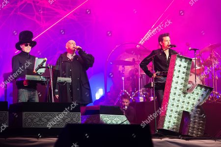 The Killers performing on the Pyramid Stage, with guest star appearance with Pet Shop Boys. Brandon Flowers, Neil Tennant, Chris Lowe