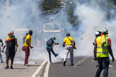 Police repel protesters with tear gas and water cannon, during cameroonian nationals living in various European countries demonstrate against the presence of Cameroon President in Geneva, on the Place des Nations in front of the European headquarters of the United Nations in Geneva, Switzerland, 29 June 2019. Cameroon's President Paul Biya is currently in Geneva.