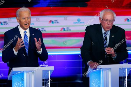 Democratic presidential candidates former vice president Joe Biden and Sen. Bernie Sanders, I-Vt., speak at the same time during the Democratic primary debate hosted by NBC News at the Adrienne Arsht Center for the Performing Arts in Miami