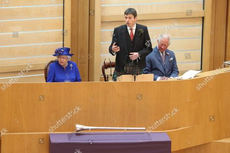 Presiding Officer of the Scottish Parliament Ken Macintosh speaks alongside Queen Elizabeth II and the Duke of Rothesay, during a ceremony marking the 20th anniversary of devolution