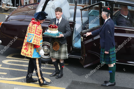 The Duke of Hamilton arrives with the Crown of Scotland at the Scottish Parliament in Edinburgh ahead of the Queen giving a speech to MSPs in the Holyrood chamber during a ceremony marking the 20th anniversary of devolution.