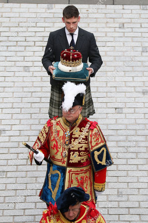 The Duke of Hamilton carries the Crown of Scotland into the Scottish Parliament in Edinburgh ahead of the Queen giving a speech to MSPs in the Holyrood chamber during a ceremony marking the 20th anniversary of devolution.