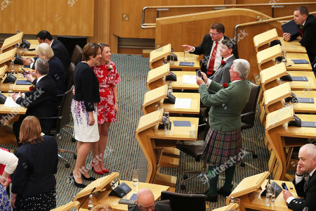 Kezia Dugdale and Jenny Gilruth have a photo taken inside the Scottish Parliament in Edinburgh ahead of the Queen giving a speech to MSPs in the Holyrood chamber during a ceremony marking the 20th anniversary of devolution.