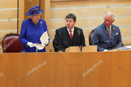 Queen Elizabeth II, alongside Presiding Officer of the Scottish Parliament Ken Macintosh and the Duke of Rothesay, giving a speech to MSPs in the Holyrood chamber at the Scottish Parliament in Edinburgh during a ceremony marking the 20th anniversary of devolution.
