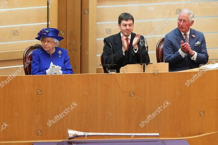 Queen Elizabeth II, Presiding Officer of the Scottish Parliament Ken Macintosh and the Duke of Rothesay, listen as First Minister Nicola Sturgeon gives a speech to MSPs in the Holyrood chamber at the Scottish Parliament in Edinburgh during a ceremony marking the 20th anniversary of devolution.