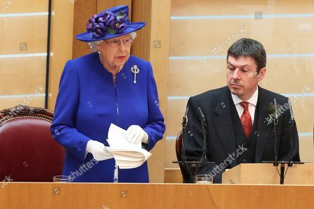 Queen Elizabeth II, alongside Presiding Officer of the Scottish Parliament Ken Macintosh, giving a speech to MSPs in the Holyrood chamber at the Scottish Parliament in Edinburgh during a ceremony marking the 20th anniversary of devolution