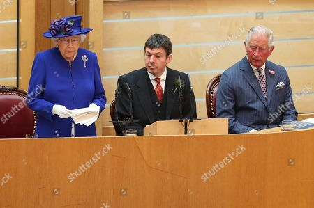 Queen Elizabeth II, alongside Presiding Officer of the Scottish Parliament Ken Macintosh and the Duke of Rothesay, giving a speech to MSPs in the Holyrood chamber at the Scottish Parliament in Edinburgh during a ceremony marking the 20th anniversary of devolution