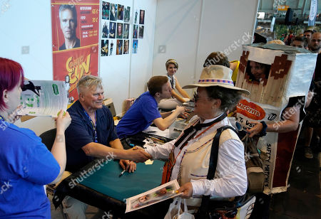 Richard Dean Anderson (L) gives autographs at the Comic Con Germany in Stuttgart, Germany, 29 June 2019. The Comic Con Germany takes place from 29 to 30 June.