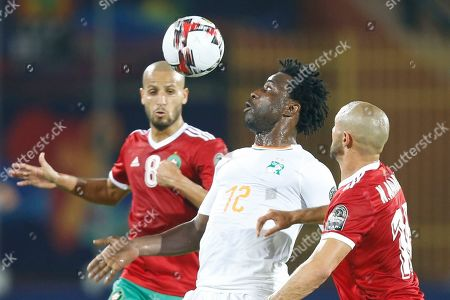 Stock Picture of Ivory Coast's Wilfried Bony, centre, controls the ball between Morocco's Karim El Ahmadi Aroussiand Morocco's Noureddine Amrabat during the African Cup of Nations group D soccer match between Morocco and Ivory Coast in Al Salam Stadium in Cairo, Egypt