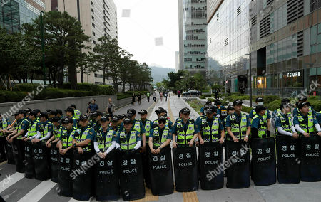 """South Korean police officers gather near the venue for a rally to oppose a visit by the U.S. President Donald Trump in Seoul, South Korea, . North Korea said Saturday President Donald Trump's offer to meet leader Kim Jong Un at the Korean Demilitarized Zone is a """"very interesting suggestion,"""" brightening prospects for a third face-to-face meeting between the two leaders"""