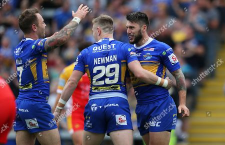 Stock Picture of Tom Briscoe of Leeds Rhinos goes over for the 2nd try...cele with Richie Myler of Leeds Rhinos and Harry Newman of Leeds Rhinos