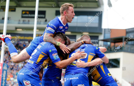 Jack Walker of Leeds Rhinos touches down for the 5th try...team cele with Richie Myler of Leeds Rhinos