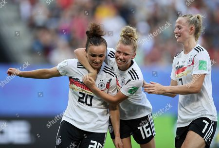 Germany's Lina Magull, left, celebrates with teammates Linda Dallmann, middle, and Lea Schueller after scoring her side's first goal during the of the Women's World Cup quarterfinal soccer match between Germany and Sweden at Roazhon Park in Rennes, France