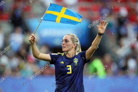 Sweden's Linda Sembrant waves her country national flag as she celebrates at the end of the Women's World Cup quarterfinal soccer match between Germany and Sweden at Roazhon Park in Rennes, France, . Sweden beat Germany 2-1