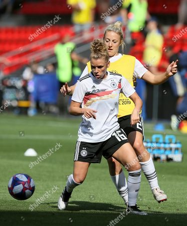 Germany's Linda Dallmann, front, with teammate Carolin Simon warm up for the Women's World Cup quarterfinal soccer match between Germany and Sweden at Roazhon Park in Rennes, France
