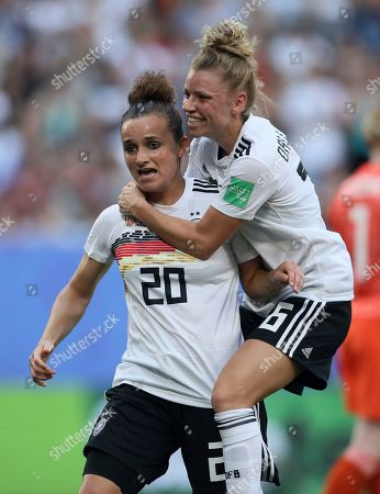 Germany's Lina Magull, left, celebrates with teammate Linda Dallmann after scores her side's first goal during the of the Women's World Cup quarterfinal soccer match between Germany and Sweden at Roazhon Park in Rennes, France