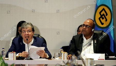 Colombian Foreign Minister, Carlos Holmes Trujillo (L), speaks next to the Minister of Foreign Affairs and Labor of Granada, Peter David (R), during installation of the Ministerial Summit Colombia - Caricom 2019, in Cartagena, Colombia, 29 June 2019. Duke asked a 'continental responsibility' to address the exodus of Venezuelans to intervene in the installation of the first summit of foreign ministers of Colombia and the Caribbean Community (Caricom).