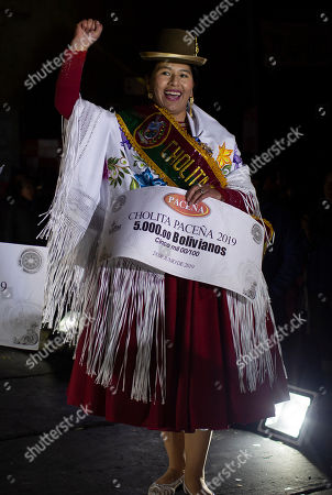 Rosa Vasquez celebrate winning the Miss Cholita Paceña 2019, beauty pageant in La Paz, Bolivia, . Aymara women participate in the pageant, an annual contest that recognizes indigenous women's fashion and beauty as well as their command of indigenous lifestyle and language